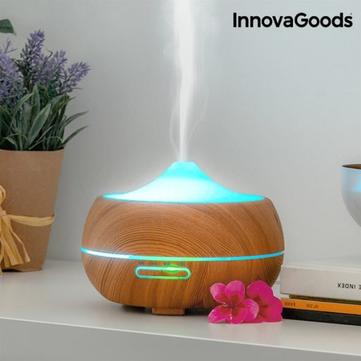 LED Diffuser timber sitting on shelf with lavender and books.