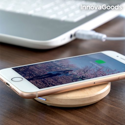 An iPhone Charging Wirelessy on Wood Charger
