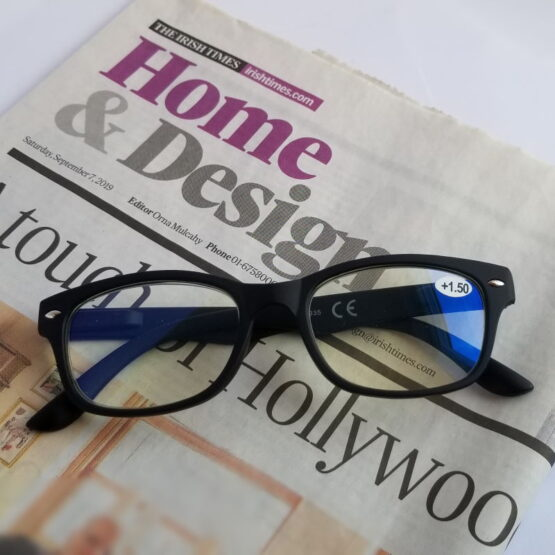 Black Framed Glasses on Irish Times Newspaper