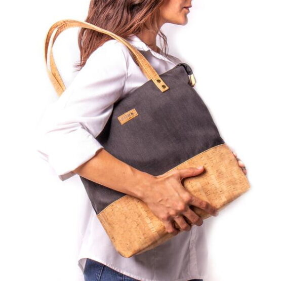 Lady carrying a cork tote bag.