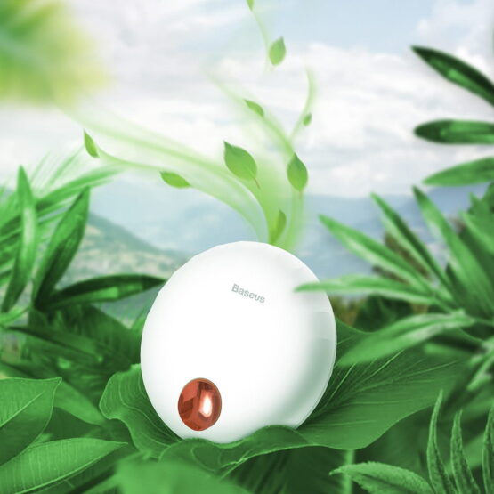 White Portable essential oil diffuser on green leaves