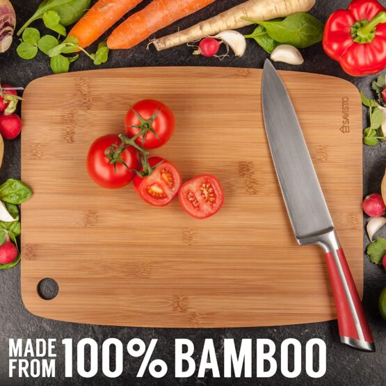 Chopping board with knife and vegetables around it.